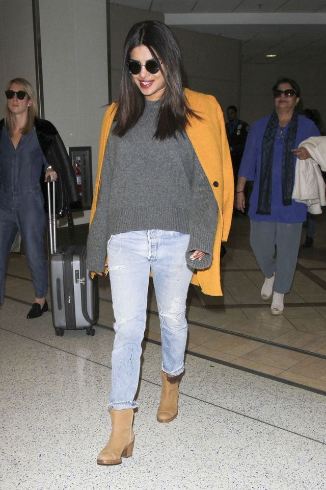 514c6ad8a21 Airport Casual  Priyanka Chopra s Gray Sweater and Mustard Coat Look for  Less