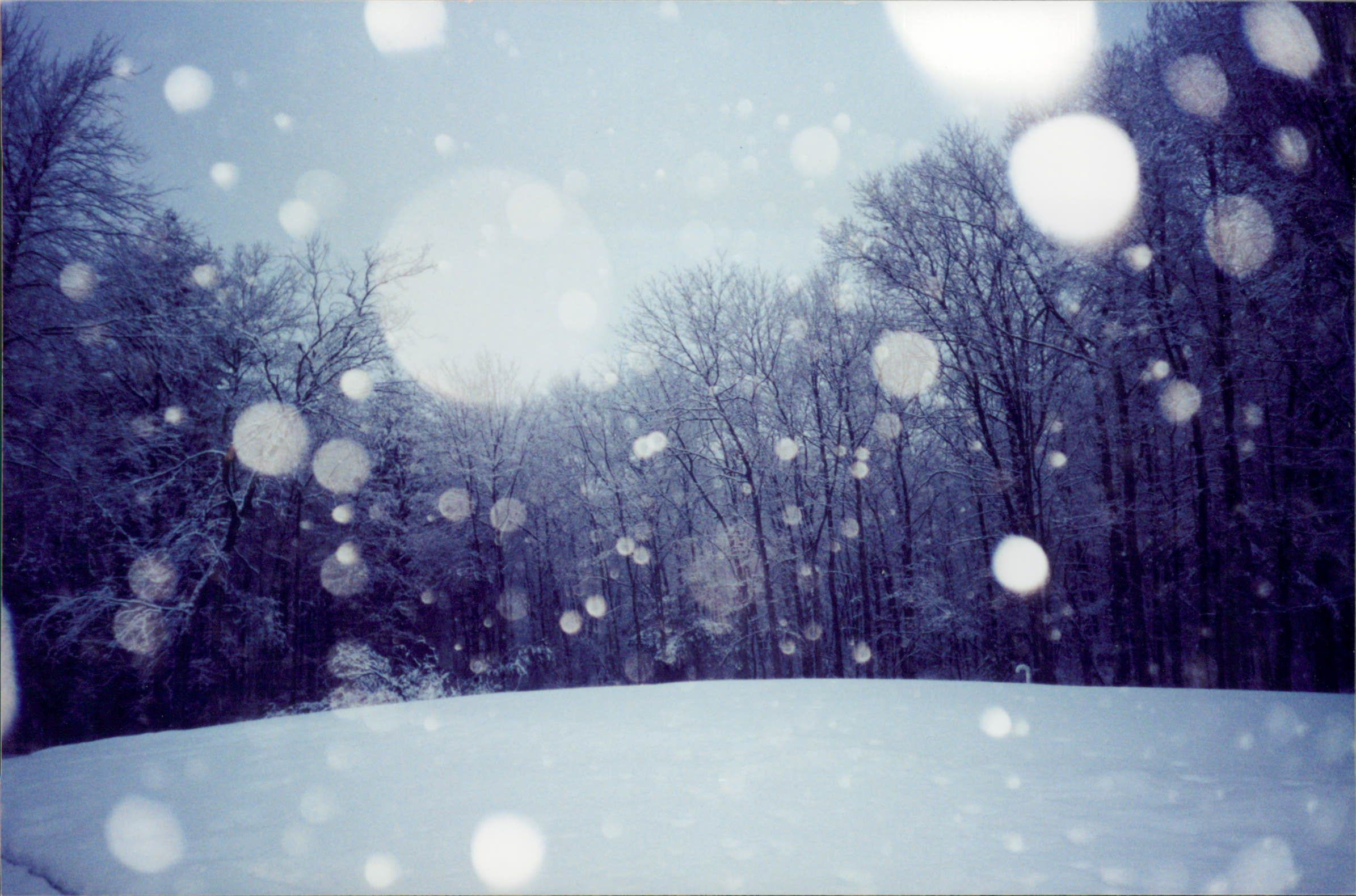 Snowflakes hitting the camera lens on a winter's day. Massachusetts. photo by Steve Golse.