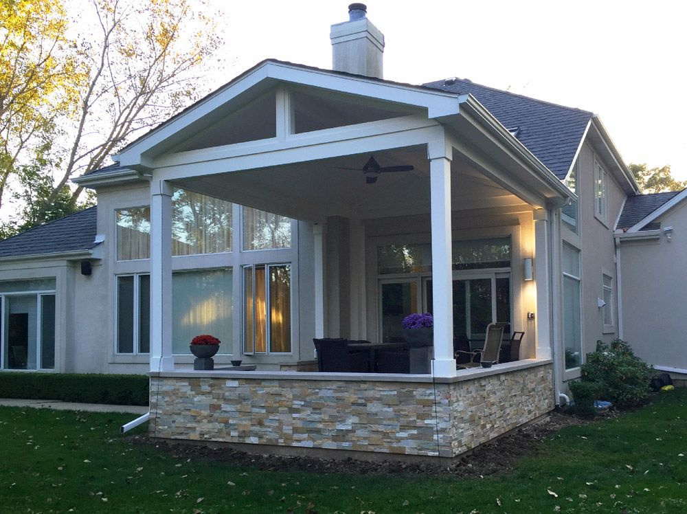 Open Back Porch With Stacked Stone Knee Wall Design Ideas