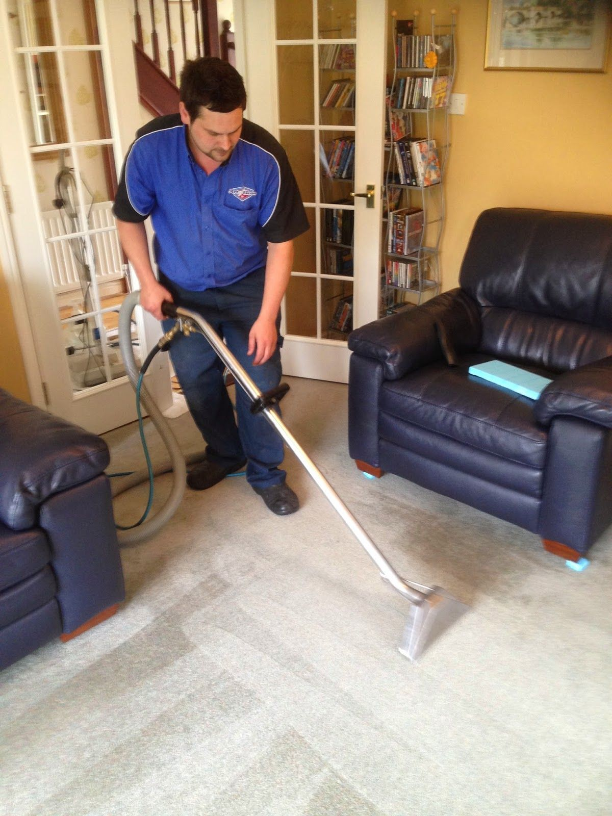 Nathan is cleaning a carpet in Cambridge.