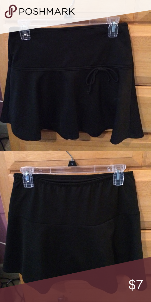 Black skirt Black skirt that comes just above the knee with a cute bow on the front. Amy Byer Skirts Circle & Skater
