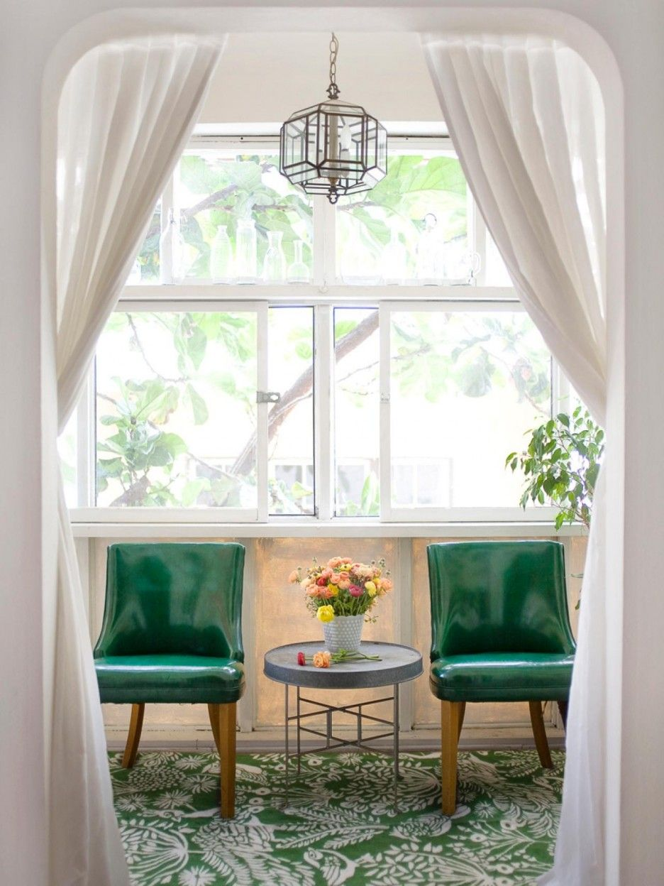 Window ideas for a sunroom  cozy sunroom design with nice green chairs learn more at