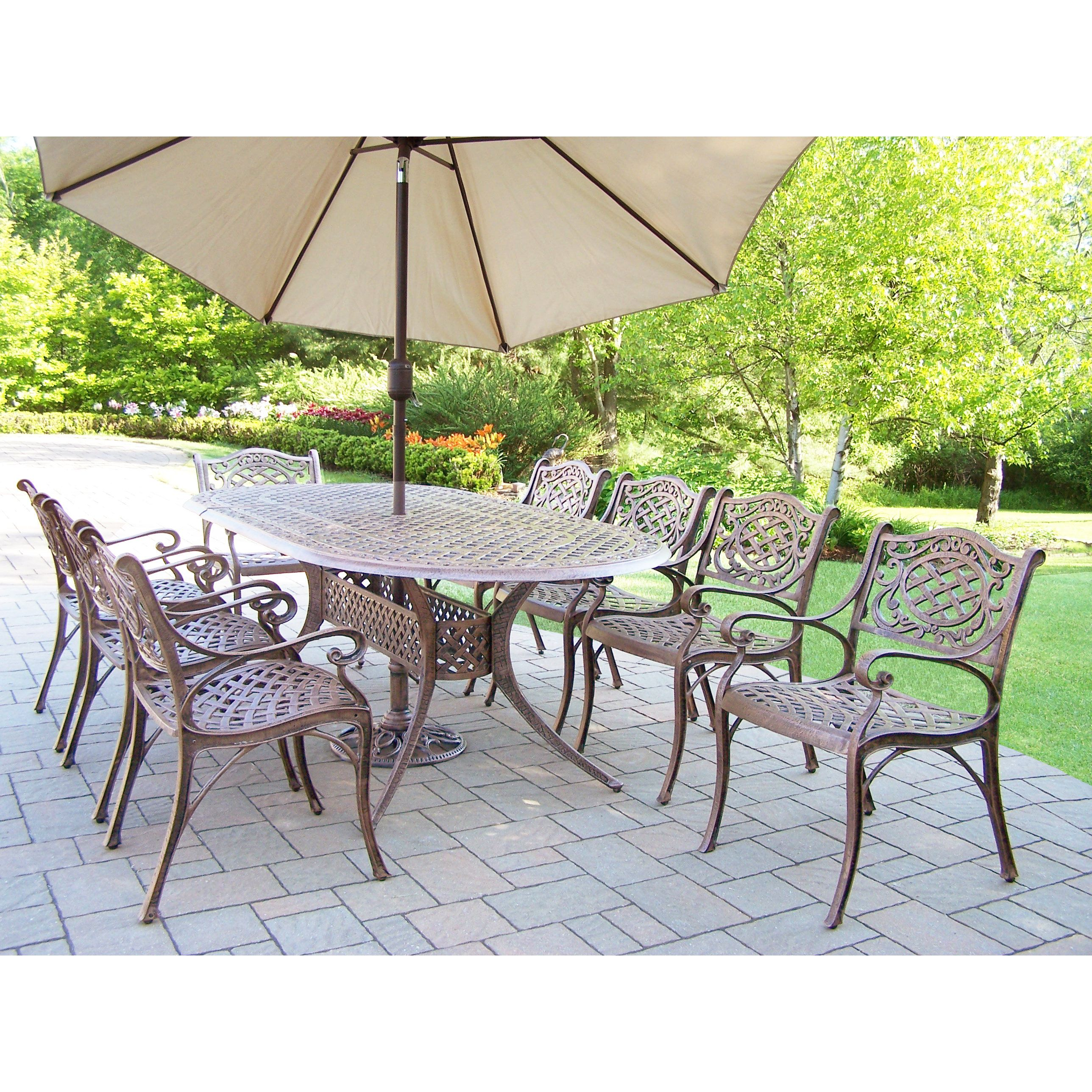 beige oval dining patio oakland living table stackable set in umbrella bronze antique mississippi piece chairs and cushioned with