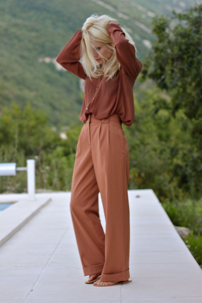 burnt orange blouse and high waisted pants - love these colors & outfit idea.