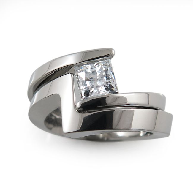 Another one of our more contemporary and sleek designs, our Etoile tension ring features a beautiful  princess cut diamond, 5x5mm, hugged by its matching companion ring