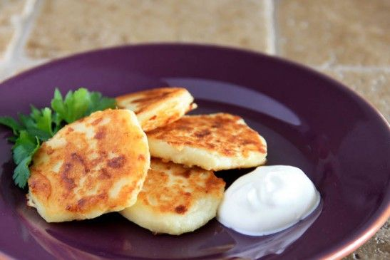 Mashed Potato Pancakes  3 cups mashed potatoes  2 cups shredded mozzarella  1 egg  1/4 cup flour  Canola oil  Topping:  Sour Cream