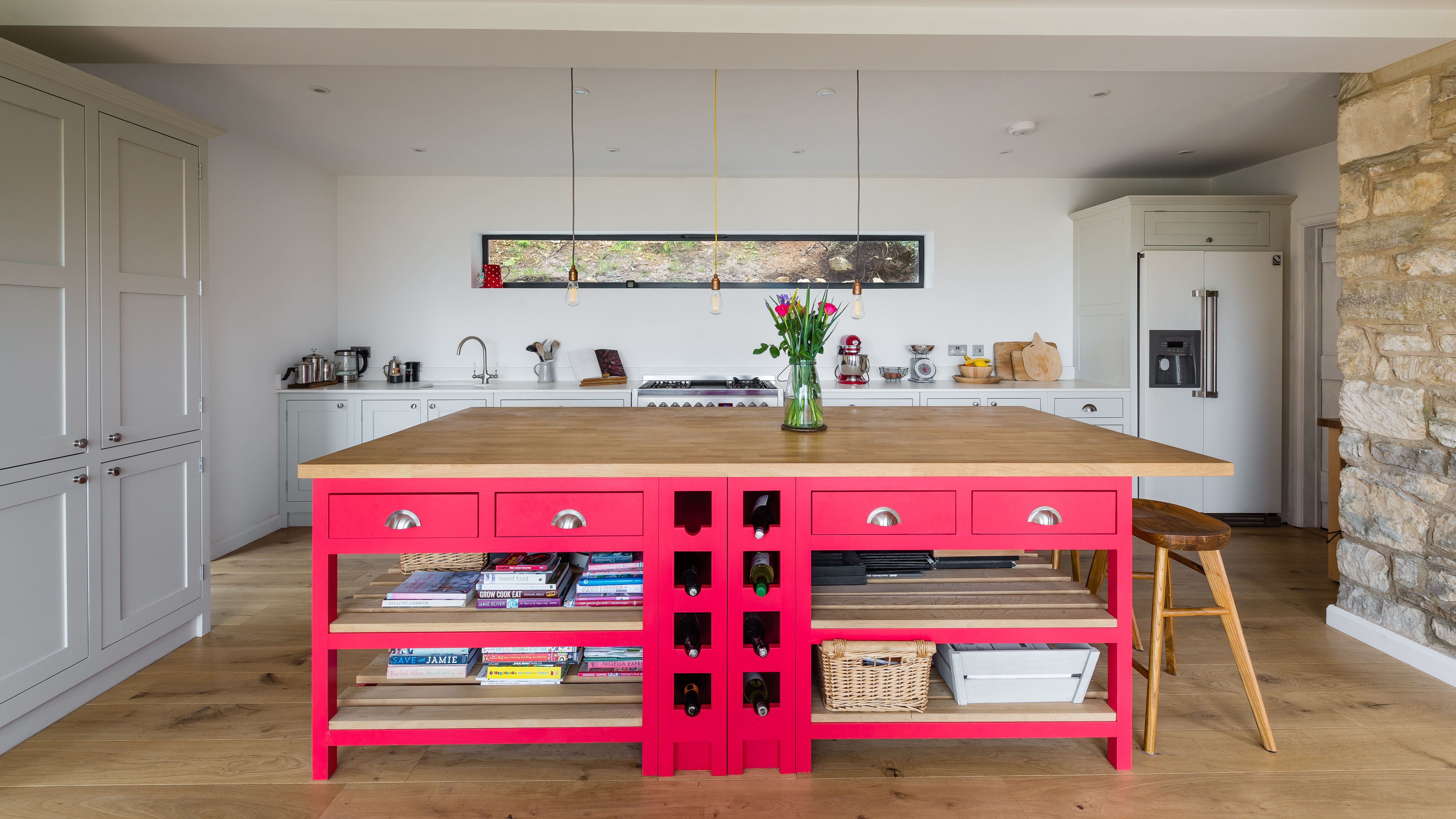 this brightly coloured kitchen island features drawers