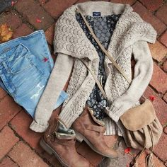 Beige cardigan, navy print top, faded boyfriend jeans, brown ankle boots, camel crossbody bag