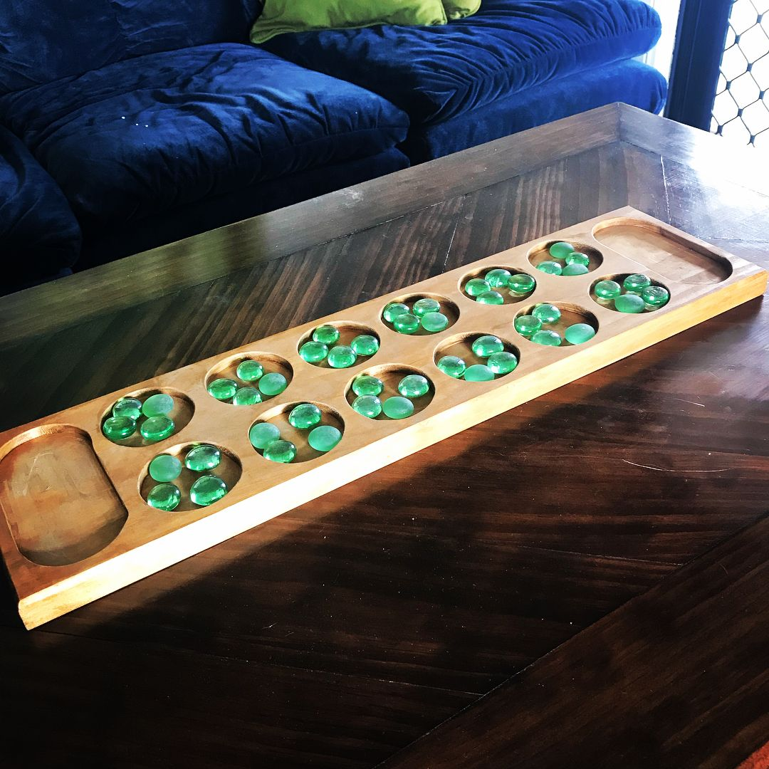 Homemade mancala board a game thats been dated at over