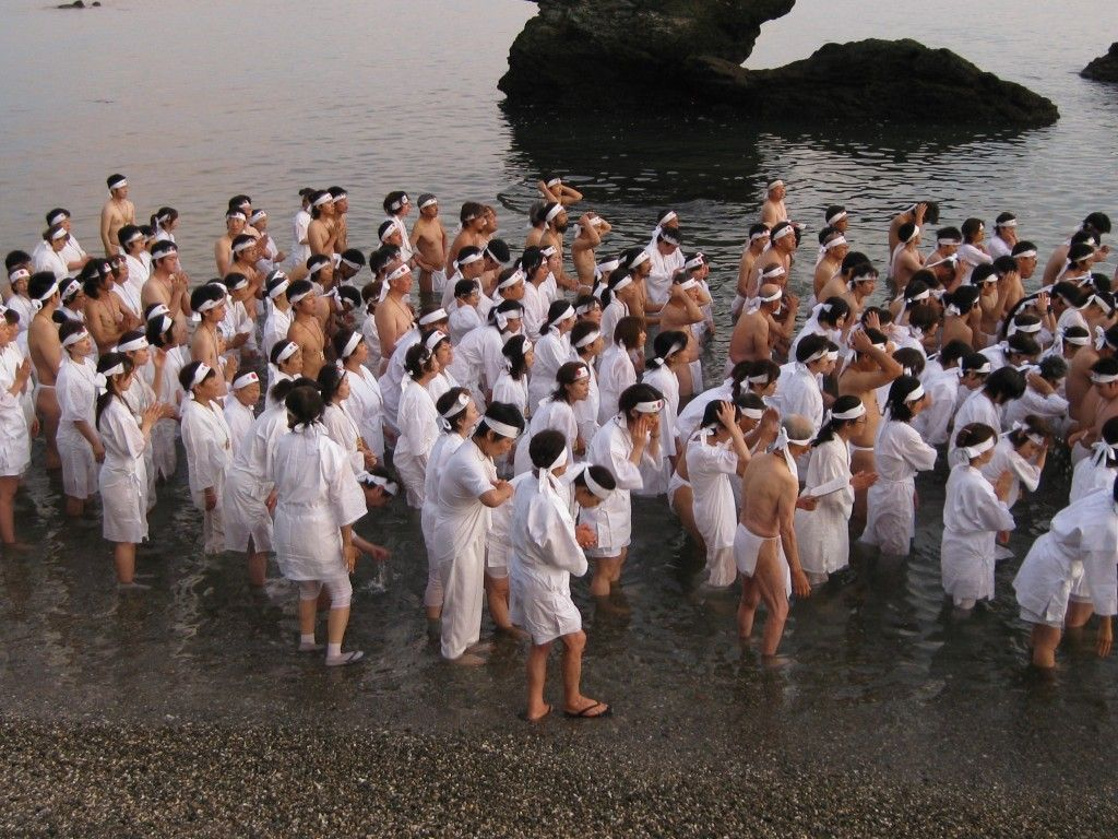 At Ise a major ritual takes place at daybreak on the morning of the summer solstice when hundreds of people enter into the sea to greet the rising sun as it appears between the sacred rocks of Futami Meoto Iwa.