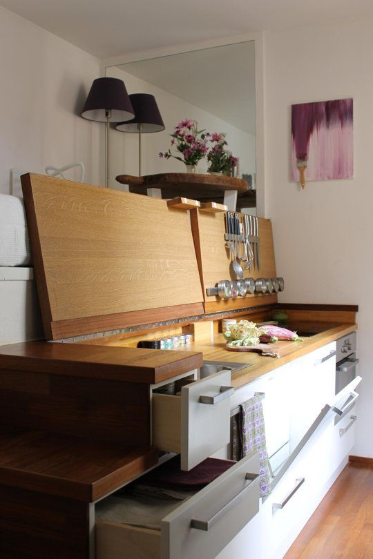 Folding counters allow for kitchen counters that can then be covered and used for other purposes
