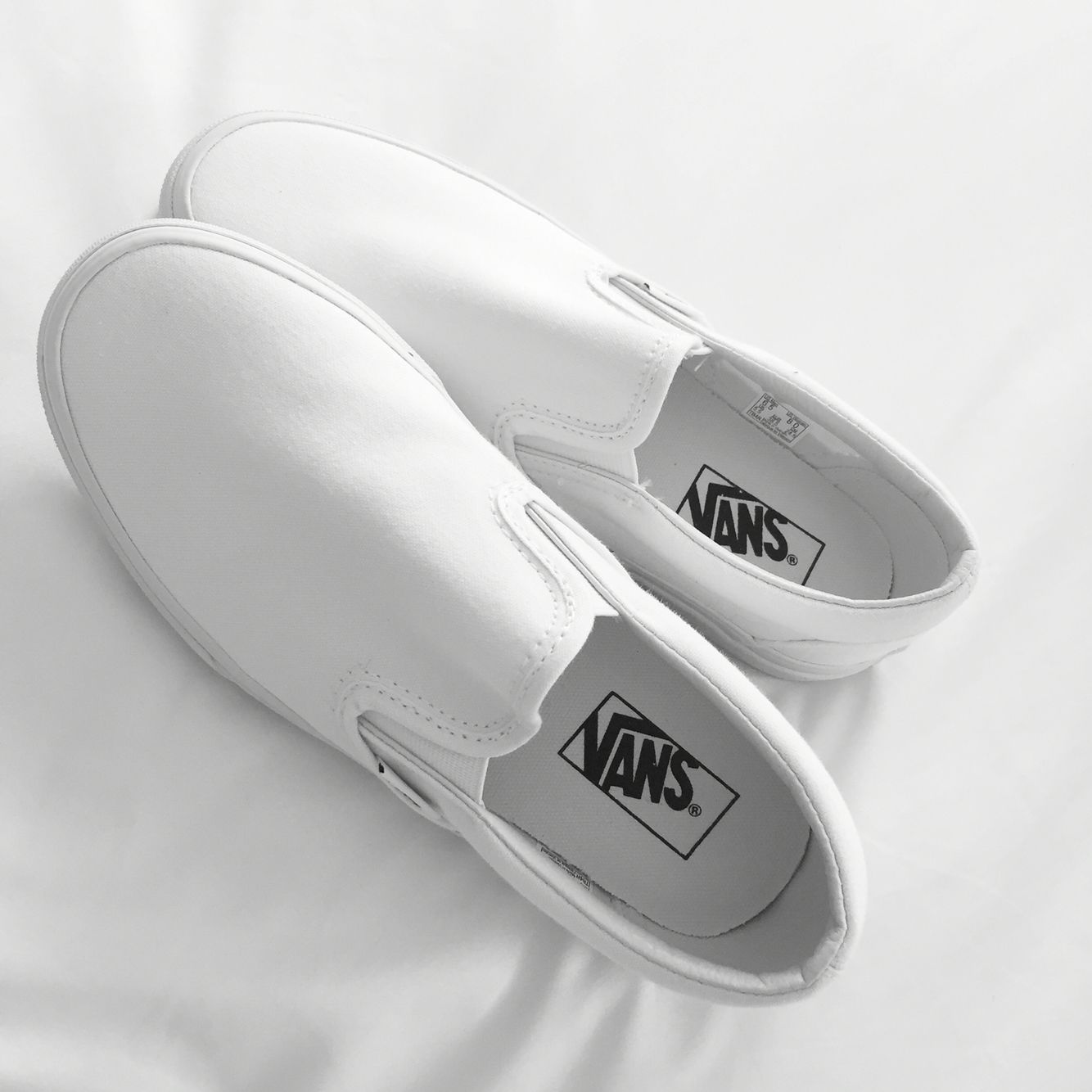 565bd01aac  50.00-Vans White Slip-On Size 7