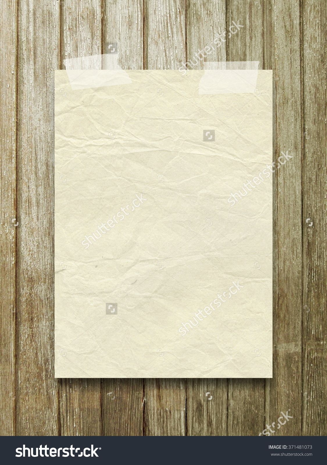 Close-up of one old vintage paper sheet with adhesive tape on brown vertical wooden boards background