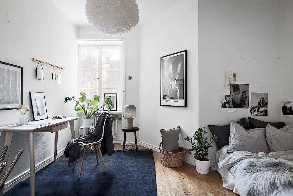 Stylish Stockholm Apartment With A Touch Of Blue Scandinavian Design Living Room Apartment Decor Apartment Interior
