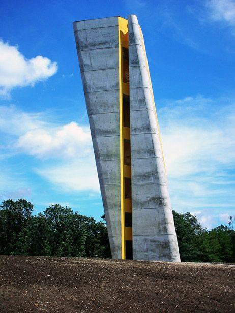 Arche Nebra / Holzer Kobler Architekturen - Nebra Observation Tower by Holzer Kobler Architekturen // Divided by a vertical crevice extending over its full height to mark the summer solstice, functioning as a solar calendar.