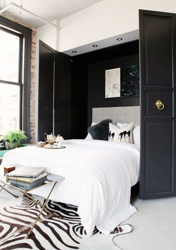 Master Bedroom With Black Walls And Zebra Hide Rug.