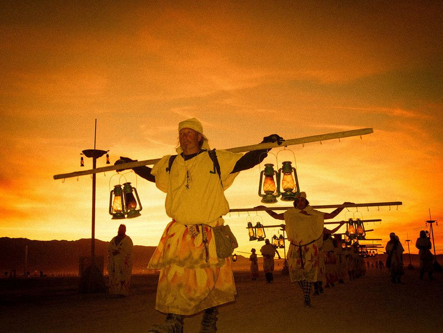Every evening, a group of #lamplighters walk through #BlackRockCity, hanging #lanterns atop tall poles. #BurningMan. from #treyratcliff at http://www.StuckInCustoms.com - all images Creative Commons Noncommercial
