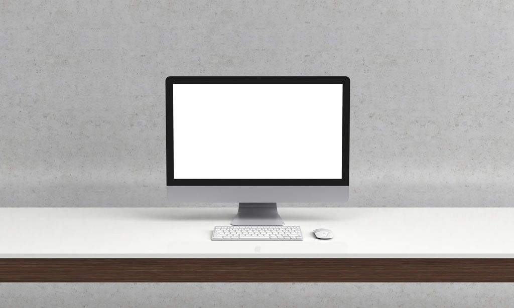 A clean and printready mockup showing an iMac on a desk
