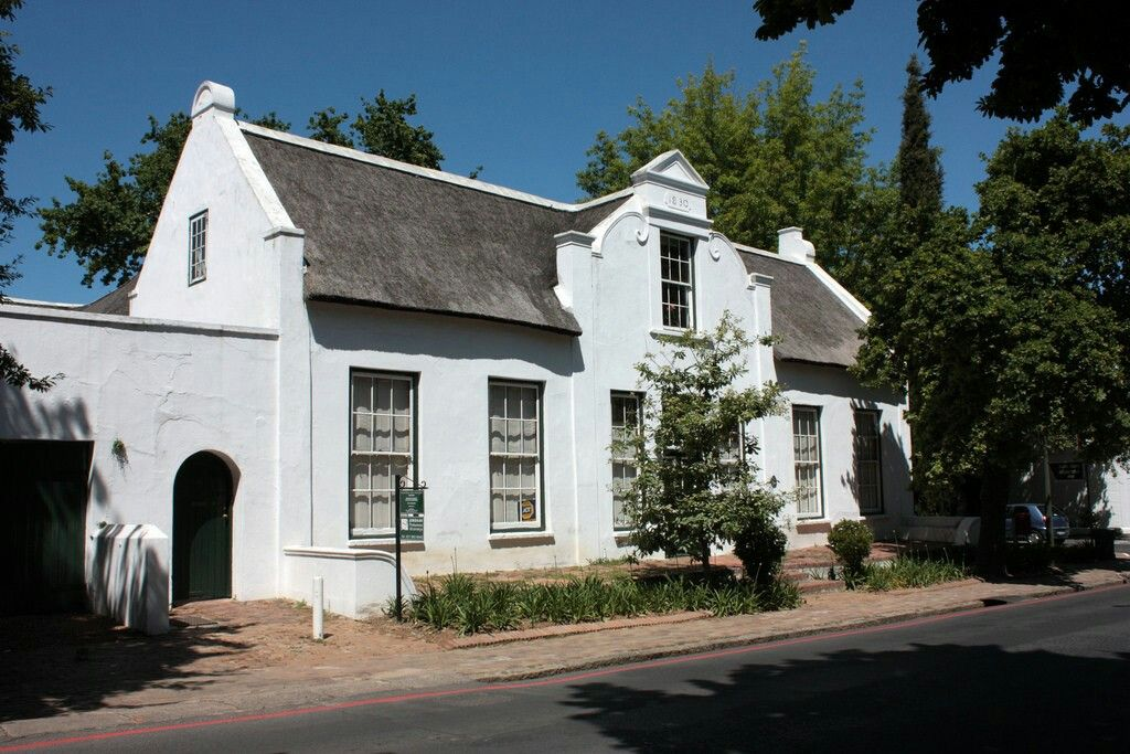 This handsome thatch-roofed Cape Dutch house with the date 1830 on the  gable is to be seen in Stellenbosch, South Africa.