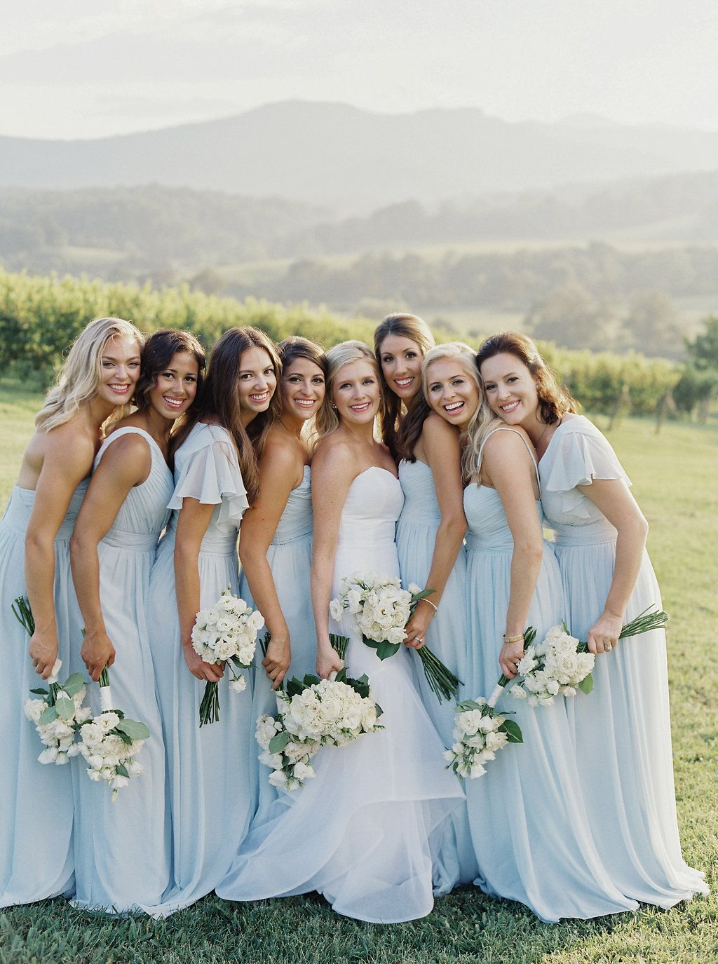 Light Blue Bridesmaids Dresses With White Rose Bouquets At Pippin