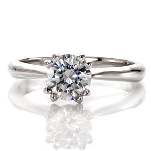 Lovely, narrow, double pronged diamond solitaire engagement ring. The band tapers in as it reaches the center stone.  Inspiration from Knox Jewelers  #solitaire