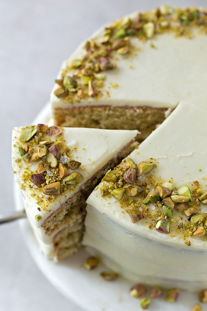 This light and fluffy pistachio layer cake is flecked with ground pistachios and flavored with just the right amount of almond. It's absolutely divine! Full recipe on: #dessert