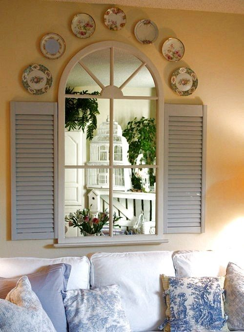 Arched Window Mirror With Blue Shutters Plates Place A Large