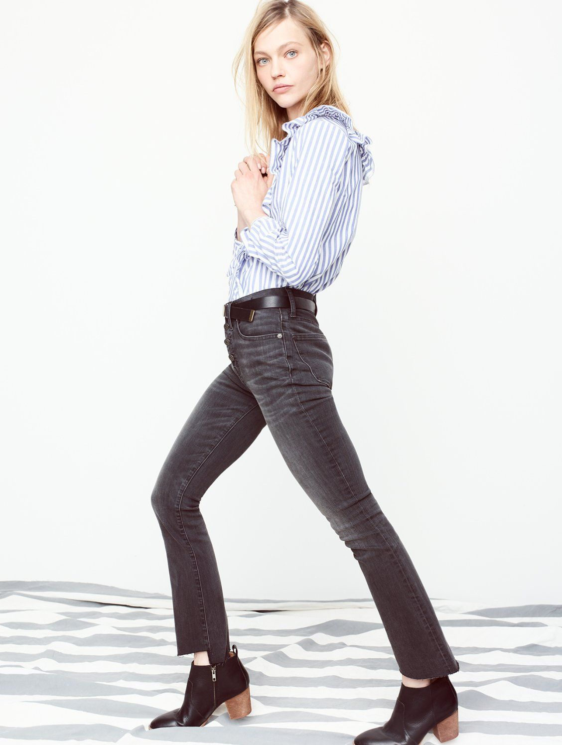 05656089e3a madewell cali demi-boot jeans  asymmetrical hem edition worn with the  striped ruffle-front blouse + brenner boot.