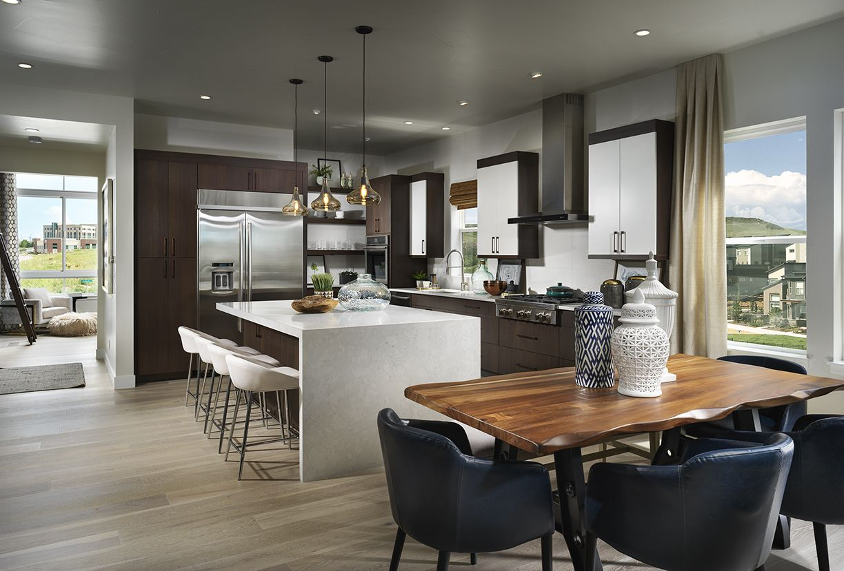 Sleek modern kitchen complete with island and waterfall