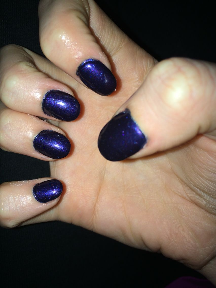 round acrylic nails, dark purple sparkles