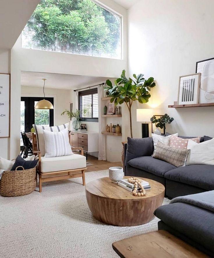 spacious living room // charcoal gray sectional sofa ...