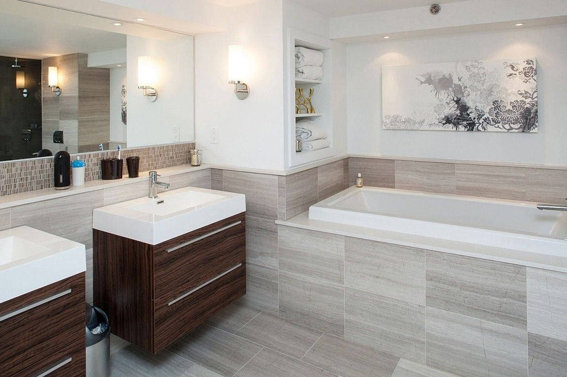 Bathroom: Elegant Bathroom Neutral Colours Stainless Steel Faucet Washbasin  Brown Cabinet Large Mirror White Bathtub