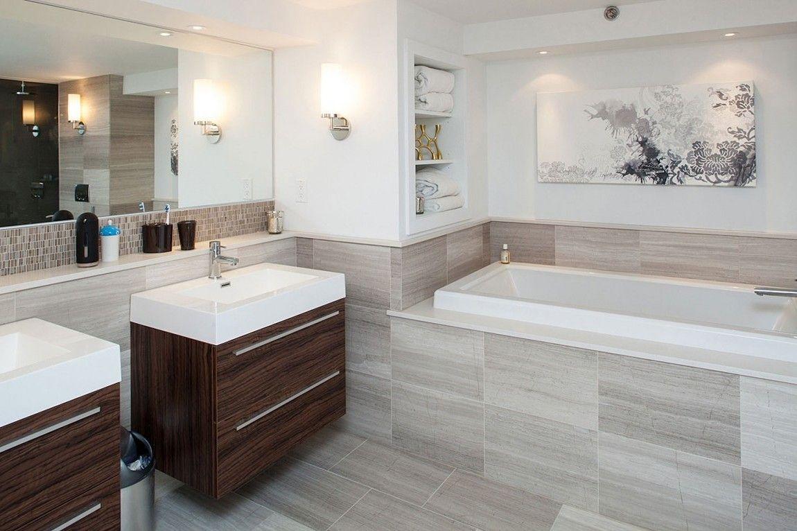 Bathroom: Elegant Bathroom Neutral Colours Stainless Steel Faucet Washbasin  Brown Cabinet Large Mirror White Bathtub