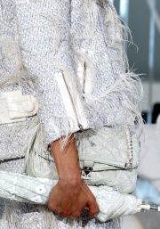 Love the Louis Vuitton Spring/Summer jacket, shoulder bag and umbrella. So stylish!