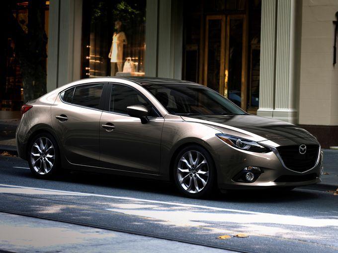 Redesigned 2014 Mazda3 four-door sedan model.