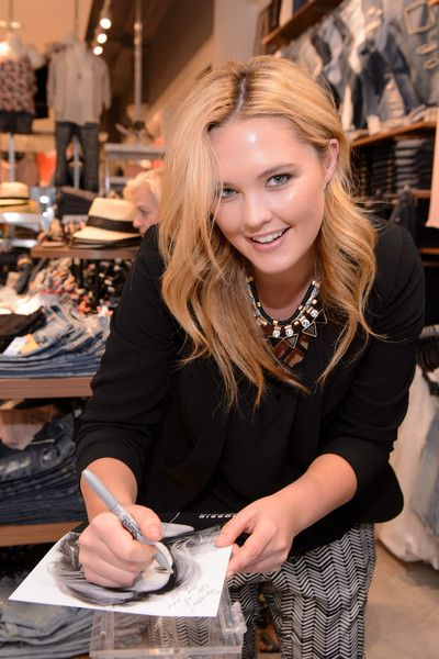 9fd2ba02c53 Georgina Burke attends the grand opening of the TORRID flagship store on  Chicago s State Street on April 8