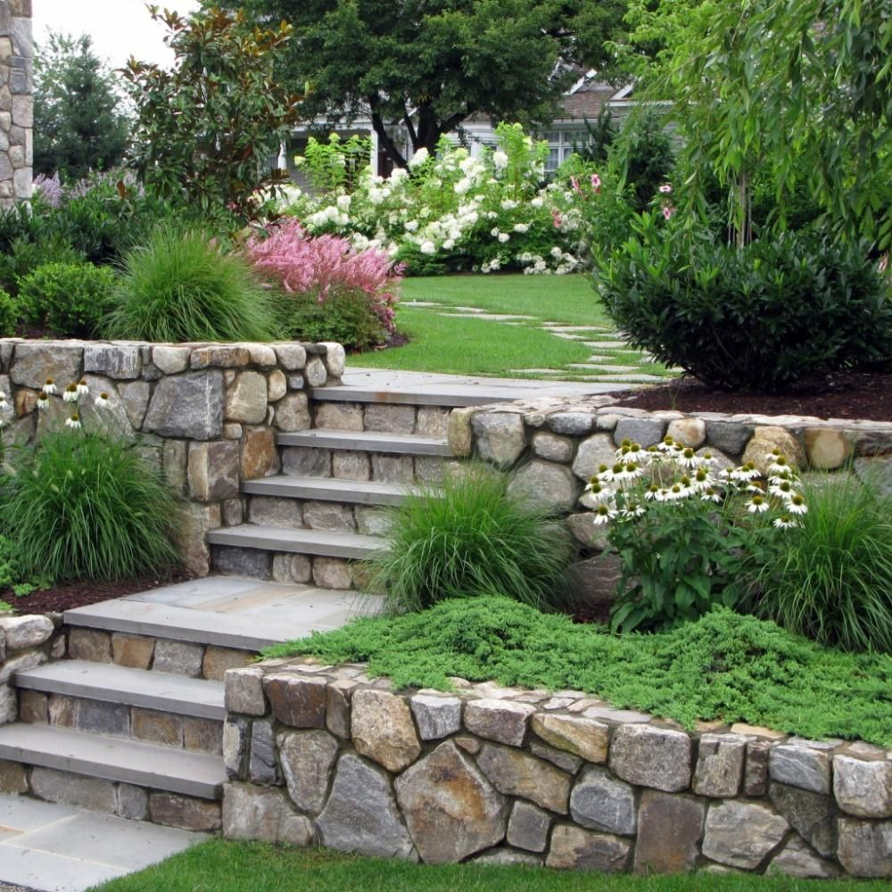 Natural stone retaining walls and steps to fight erosion for Rock wall garden designs