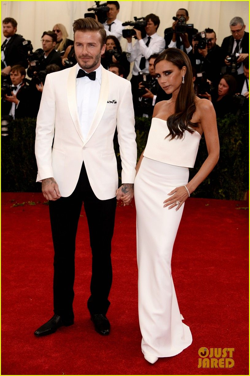 Victoria & David Beckham   #MetGala   Victoria is wearing a gown from her own collection.  Met Gala 2014.