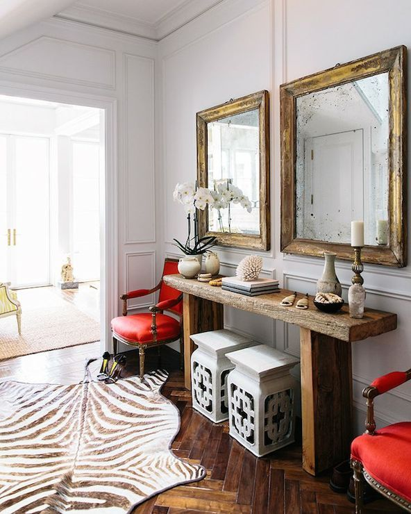 High Quality Susan Greenleaf   Chic Foyer Features White Chinoiserie Garden Stools  Tucked Under Reclaimed Wood Console Table Flanked By Red French Chairs On  Full Wall ...