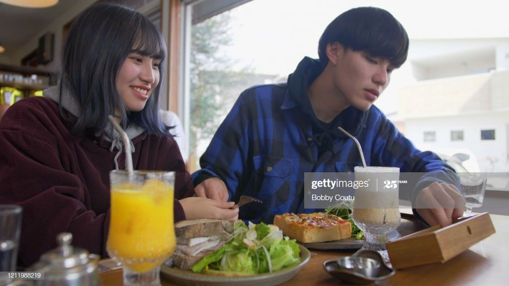 Young Asian Couple At Cafe Eating Vegetarian Sandwich Photography #Ad, , #Ad, #Couple, #Cafe, #Young, #Asian