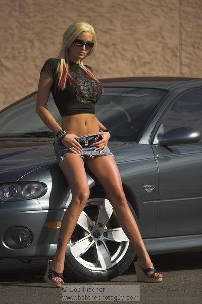 Women posing on cars #9
