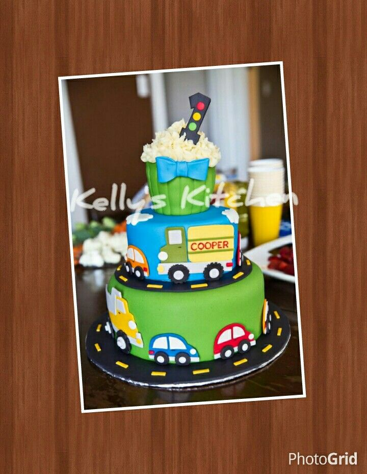 Car truck themed first birthday cake The oversized cupcake was
