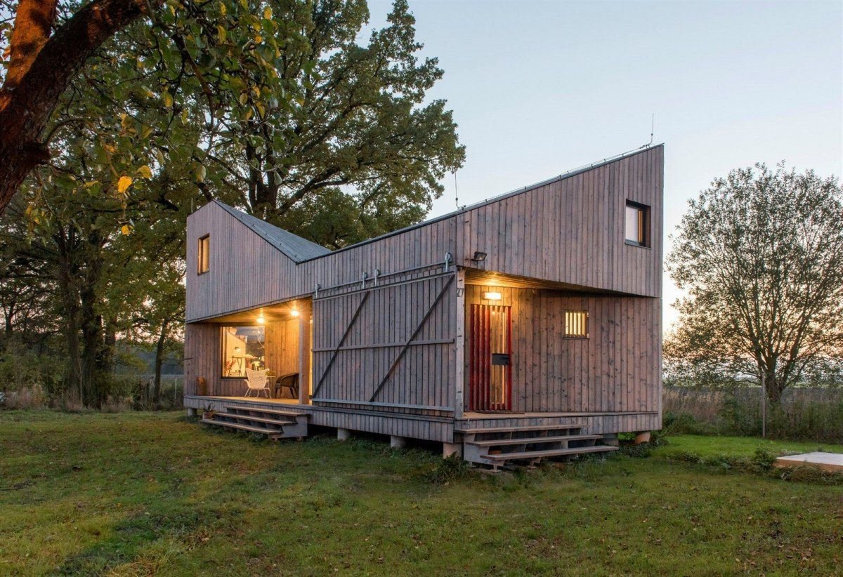 A distinctive folded roof tops this small energy-efficient house in Bohemia.