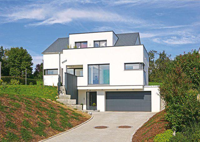 Einfamilienhaus der familie ziegler von fertighaus weiss for Modernes haus in hanglage