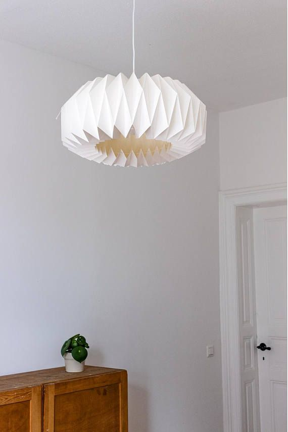 Origami lampshade ZÜRICH is entirely hand folded from 3 meters of thick white paper. The shade was invented and designed by Faltblatt, what makes the piece really inimitable and unique. ZÜRICH has a round form and its closed on the top, but open from the bottom and can be regulated with