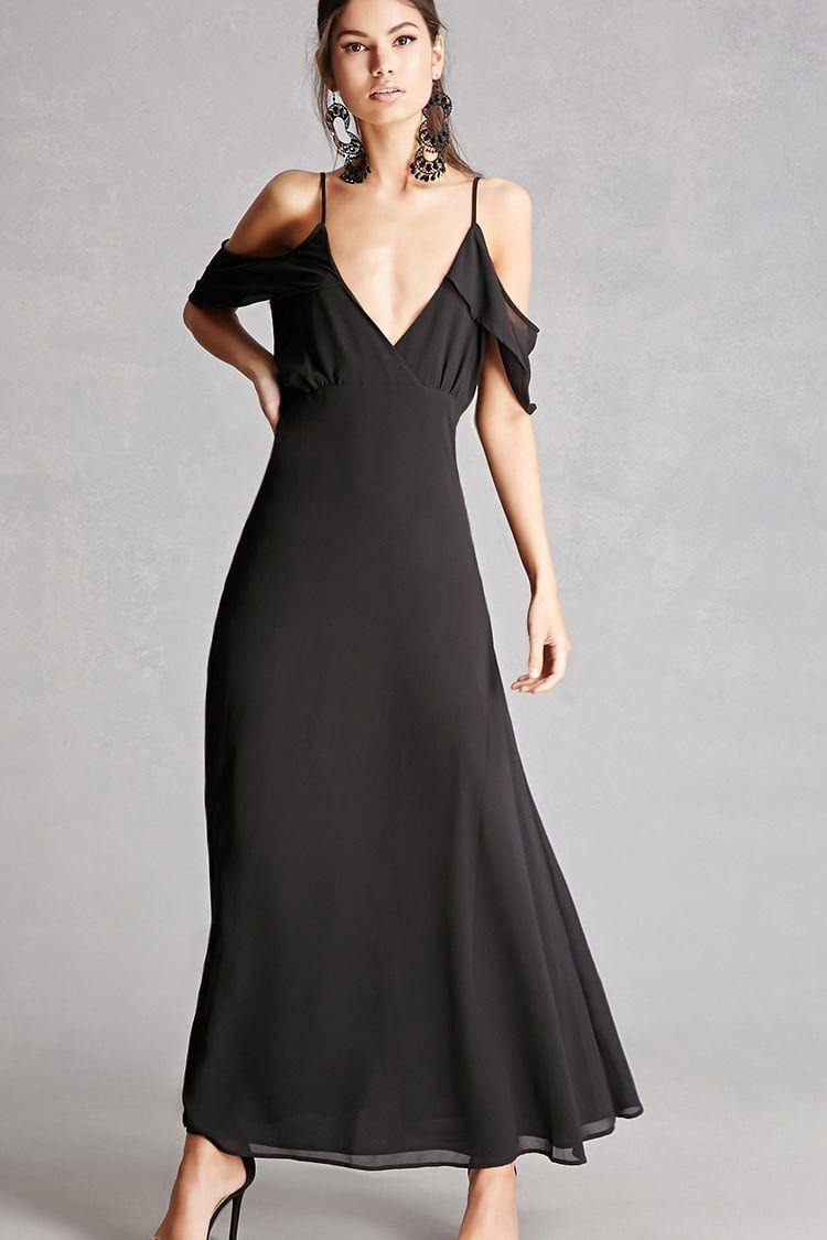 A woven maxi dress featuring a plunging neckline an openshoulder