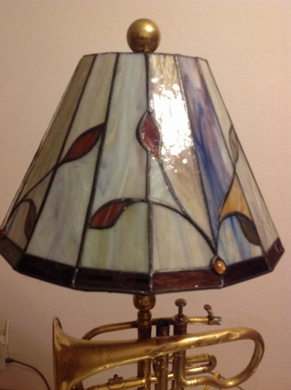 Antique brass cornet lamp with stained glass shade the lamp is antique brass cornet lamp with stained glass shade the lamp is mounted on a marble keyboard keysfo Gallery