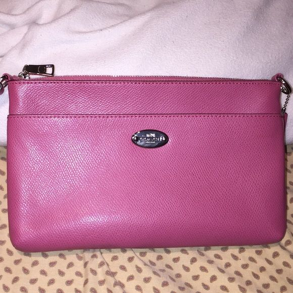Coach clutch/ wristlet Pebbled  leather clutch / wristlet pink mint condition dimensions : 9.5 in. Length.  6.5 in. Height Coach Bags Clutches & Wristlets