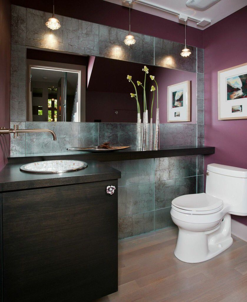 deep dark colors are prominent in this bathroom as even the light hardwood floor seems to reflect a soft dark tone mirrored tiles used on the wall behind - Light Hardwood Bathroom 2015