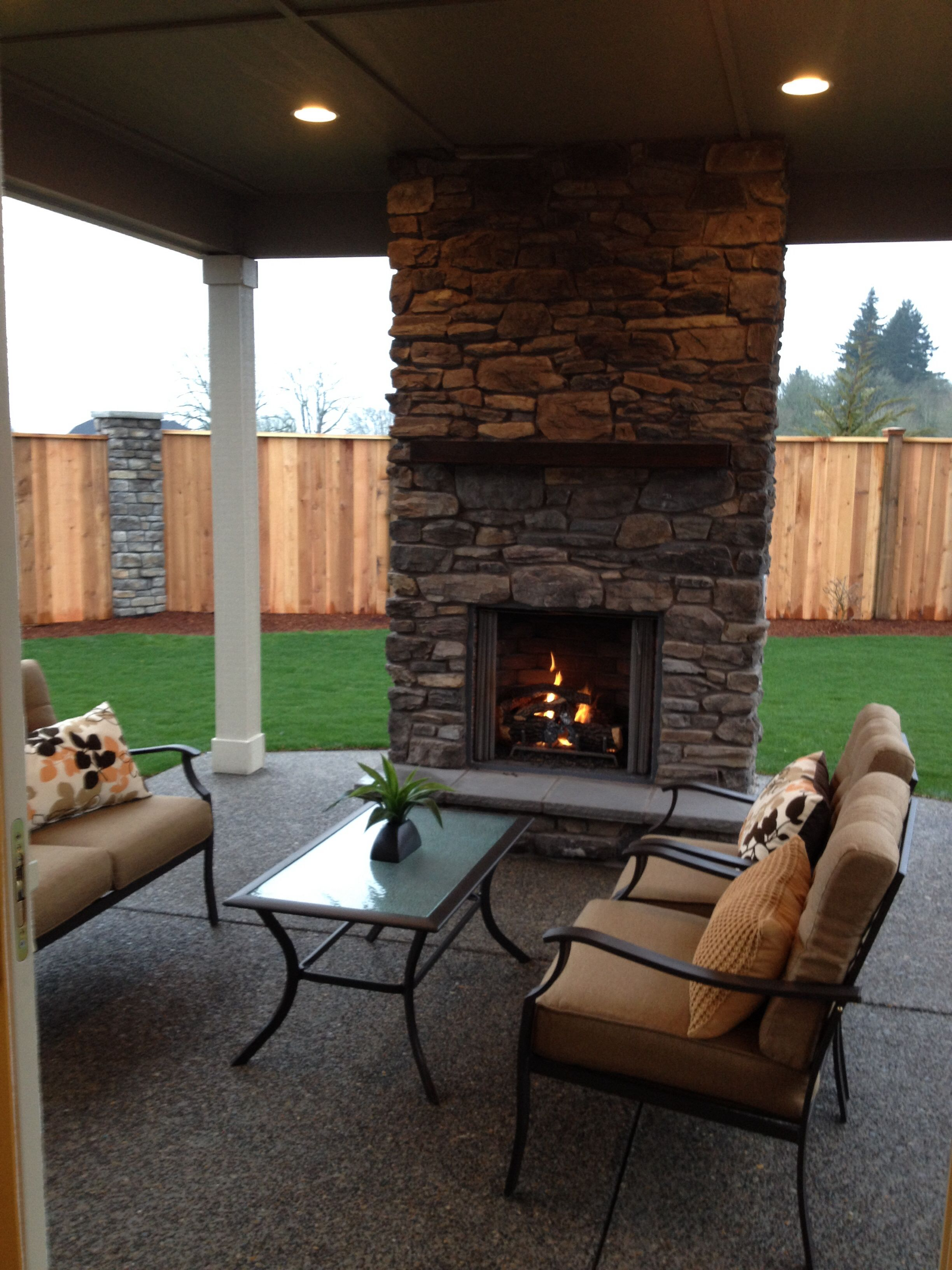 Covered patio with fireplace at one of my model homes for Covered porch with fireplace